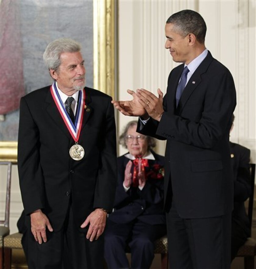 President Barack Obama stands with Yakir Aharonov, a professor at Chapman University in California recognized for his work in quantum mechanics, during a ceremony for recipients of the National Medal of Science and the National Medal of Technology and Innovation, the highest honors bestowed by the