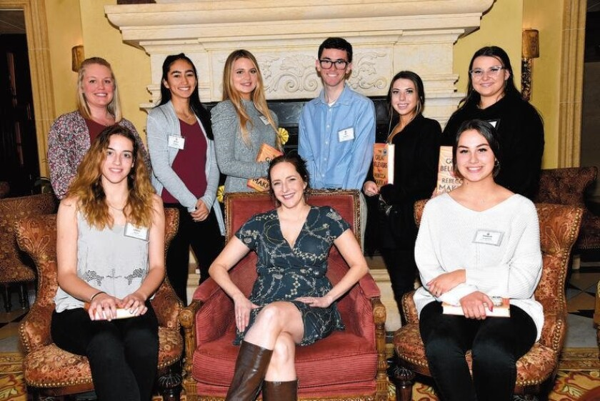 Cathedral Catholic High School teacher Brittney Cairns, students Salina Voegtly, Samantha Fay, Ian Grooms, Aubrey Filler, Anna Mendez Fogarty. Seated: Students Lindsey Miller, author Rebecca Makkai, Madison Stoddard