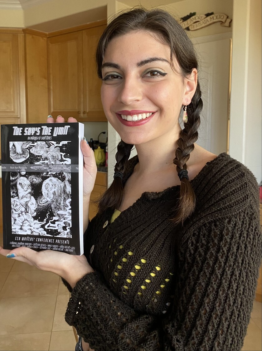 Sophie Camilleri with the 10th anniversary anthology, The Sky's the Limit.
