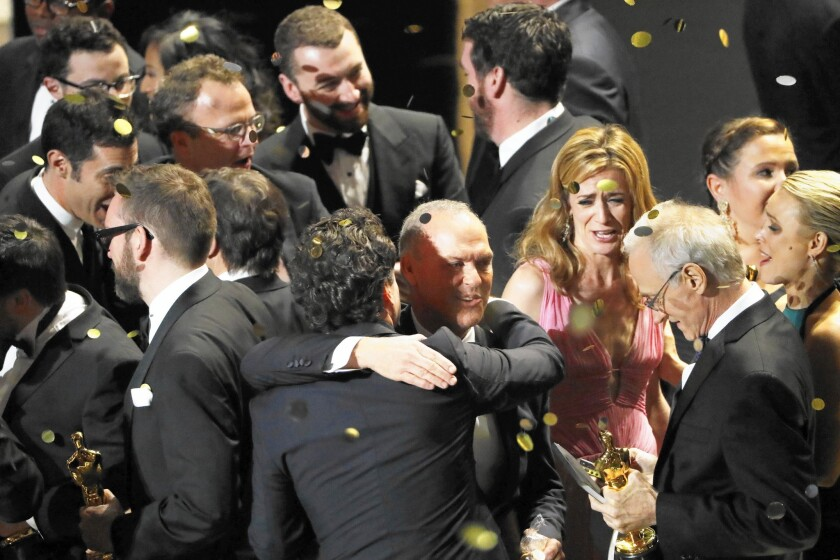 """Michael Keaton and the cast and producers of """"Spotlight"""" celebrate after winning best picture at the 88th Academy Awards on Feb. 28, 2016, at the Dolby Theatre at Hollywood & Highland Center in Hollywood."""