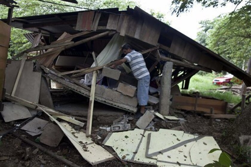 Wilber Sequeira searches for recoverable items in his earthquake damaged home in Nosara, Costa Rica, Thursday, Sept. 6, 2012. A powerful, magnitude-7.6 earthquake shook Costa Rica and a wide swath of Central America on Wednesday. (AP Photo/Esteban Felix)