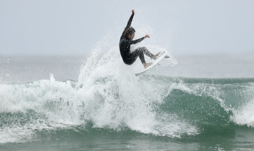 Toby Dussault, 17, surfs at Seaside Reef at Cardiff State Beach on June 30.