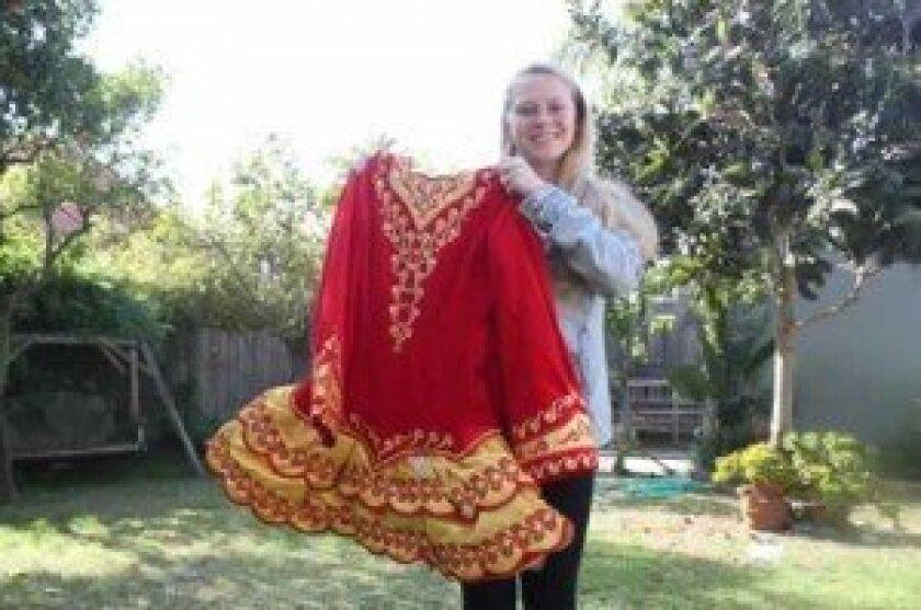 Margaret haerr holds her solo dress. Ashley Mackin