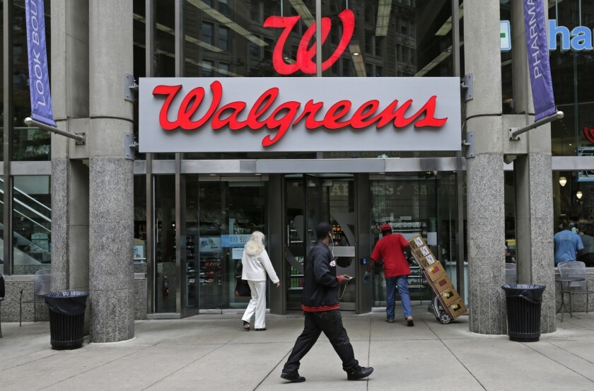 This June 4, 2014, file photo, shows a Walgreens retail store in Boston. Walgreens has agreed to pay $5.5 million to resolve allegations that it overcharged for prescriptions covered by the Massachusetts workers' compensation insurance system.