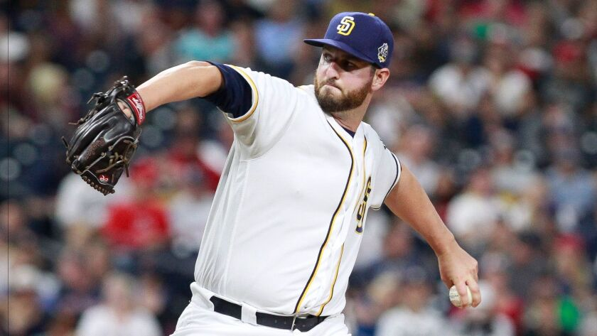The Padres' Keith Hessler piches to the Red Sox's in the eighth inning.