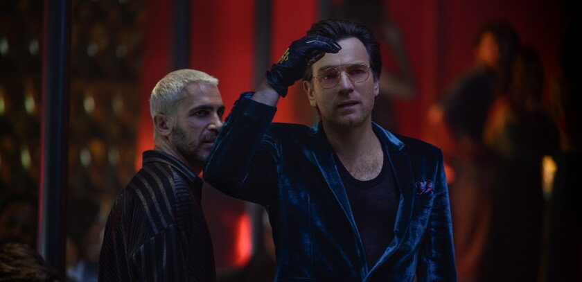 "Chris Messina, left, and Ewan McGregor in the movie ""Birds of Prey (and the Fantabulous Emancipation of One Harley Quinn)."""