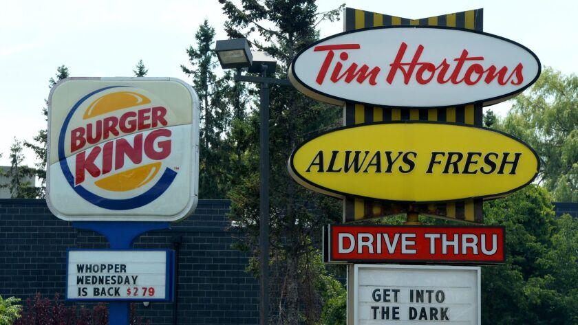 Restaurant Brands International has pledged to limit the use of antibiotics in the chicken it buys for its Burger King and Tim Hortons restaurants.
