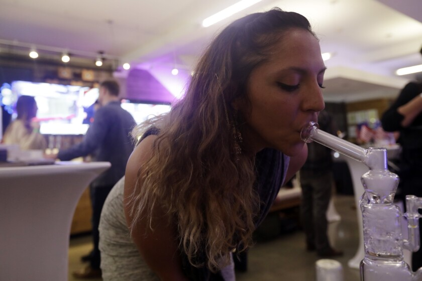 Krystal Xiques smokes marijuana at a November rally in support of Proposition 64 at Sparc Dispensary in San Francisco.