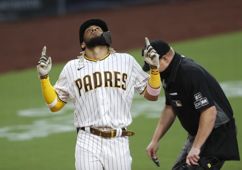 The Padres' Fernando Tatis Jr. celebrates a solo home run.