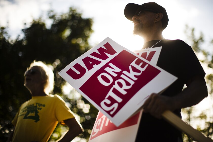 Workers picket outside a General Motors facility