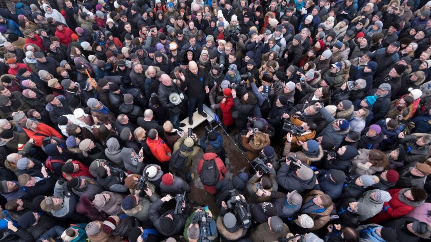 Protesters against the transfer of St. Isaac's Cathedral to the Russian Orthodox Church gather at Marsovo field in St. Petersburg, Russia, on Jan. 28, 2017.