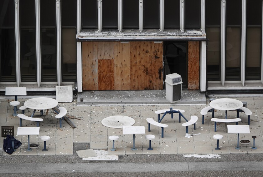 Debris covers a patio area at the former Sempra Energy building at 101 Ash Street in downtown San Diego