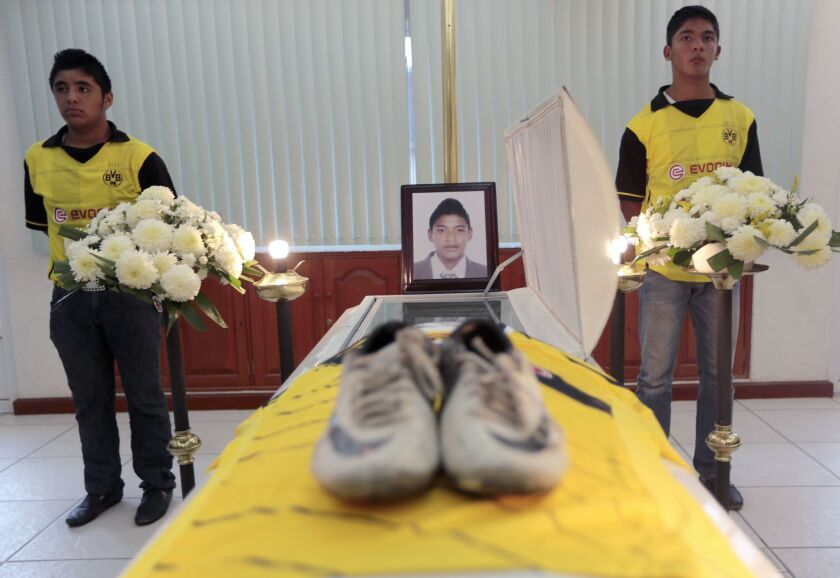 Teammates of soccer player David Garcia attend his funeral in Chilpancingo, Guerrero state, Mexico, on Saturday.