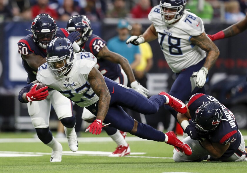 Tennessee Titans running back Derrick Henry dives for a first down Sunday against the Houston Texans.