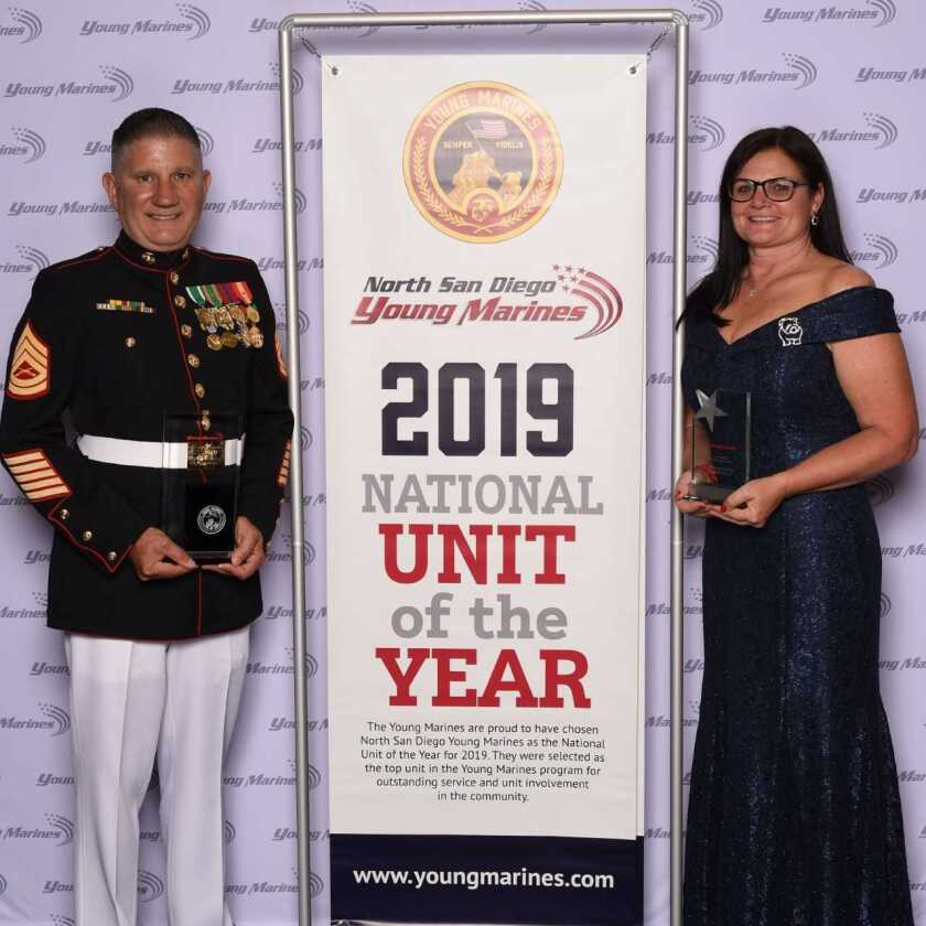 """Cal Grimes, unit commander of North San Diego Young Marines and Marie Smith, adjutant of North San Diego Young Marines, at the Young Marines Adult Leaders Conference in Orlando, Fla., after they won """"National Unit of the Year"""" for 2019."""