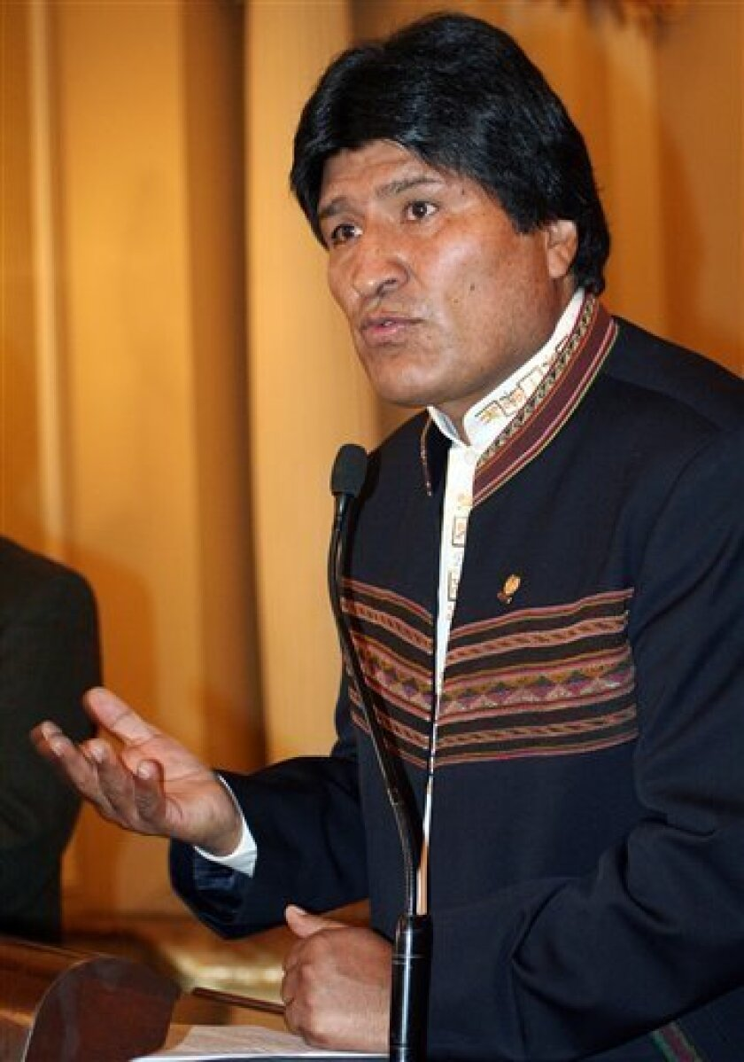 In this photo released by Bolivia's Government Press Office, Bolivia's President Evo Morales  speaks at a ceremony for ambassadors to Bolivia at the government palace in La Paz, Wednesday, Jan. 14, 2009. Morales announced Wednesday he was breaking relations with Israel over its invasion of the Gaza
