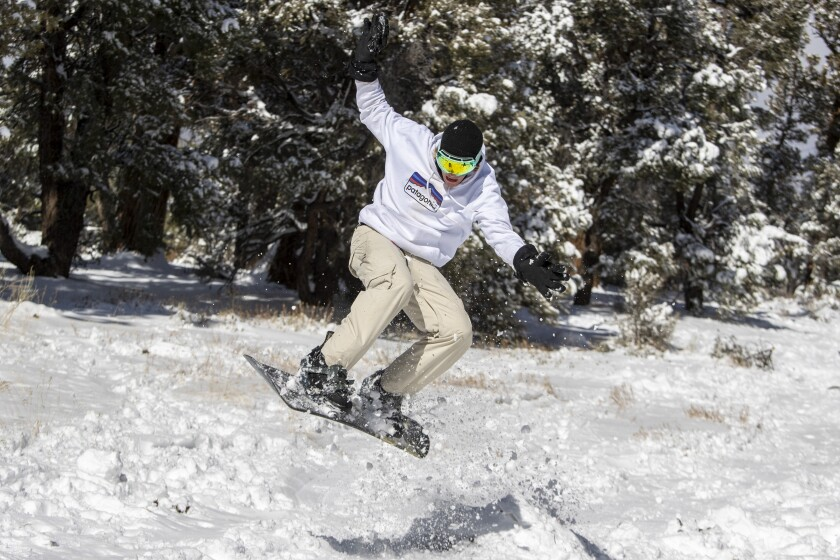 Jake Kentner, 20, backcountry snowboards with friends in some fresh snow near Big Bear Lake.