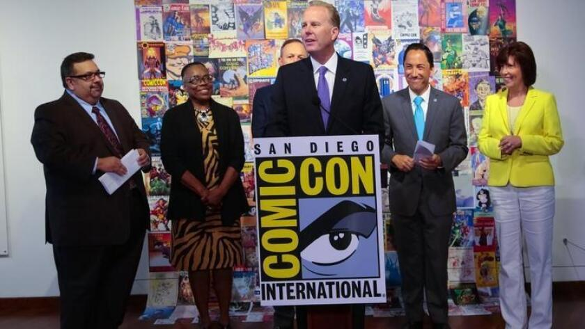 At a Thursday morning press conference, San Diego Mayor Kevin Faulconer along with Comic-Con Spokesman David Glanzer (far left) announced a deal to keep Comic-Con in San Diego through 2018 (/ Nelvin C. Cepeda)