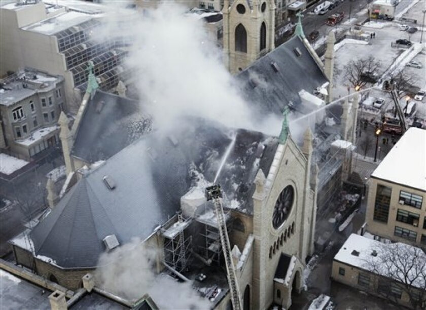 Chicago firefighters work in freezing temperatures on an extra-alarm fire at the Holy Name Cathedral, the seat of Cardinal Francis George, in Chicago, Wednesday, Feb. 4, 2009. (AP Photo/Charles Rex Arbogast)