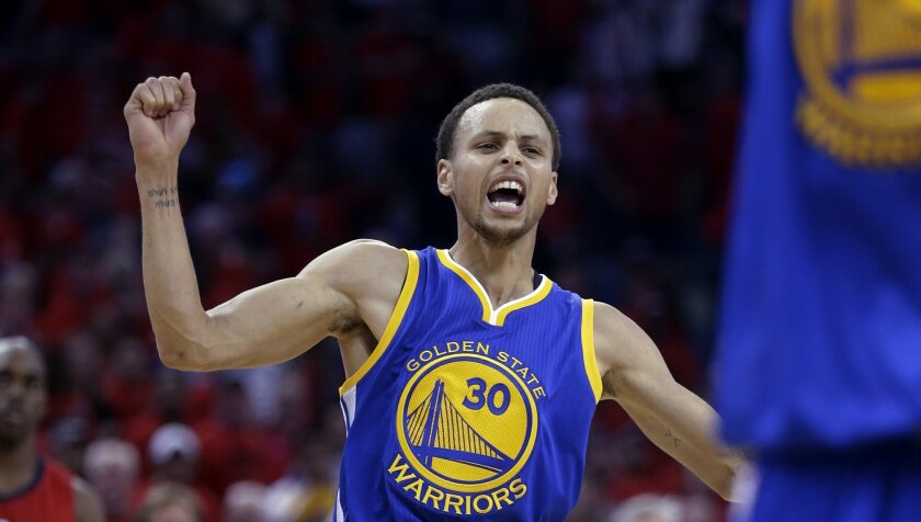 Golden State Warriors guard Stephen Curry celebrates the Warriors' 123-119 overtime victory over the New Orleans Pelicans in Game 3 of a first-round NBA basketball playoff series in New Orleans, Thursday, April 23, 2015. The Warriors took a 3-0 lead in the best-of-seven series. (AP Photo/Gerald Her