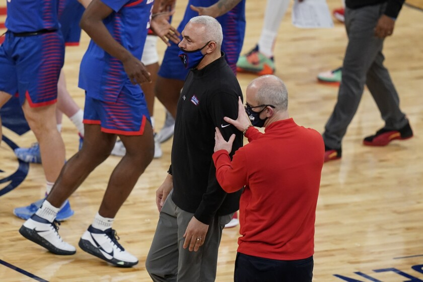 Connecticut coach Dan Hurley, right, talks to DePaul coach Dave Leitao after an NCAA college basketball game in the Big East men's tournament Thursday, March 11, 2021, in New York. (AP Photo/Frank Franklin II)