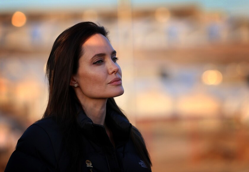 Actress Angelina Jolie visits a camp for displaced Iraqis in Khanke, a few miles from the Turkish border, in January. Jolie announced in a New York Times op-ed Tuesday that she had undergone a second elective surgery to deal with her genetic cancer risk.