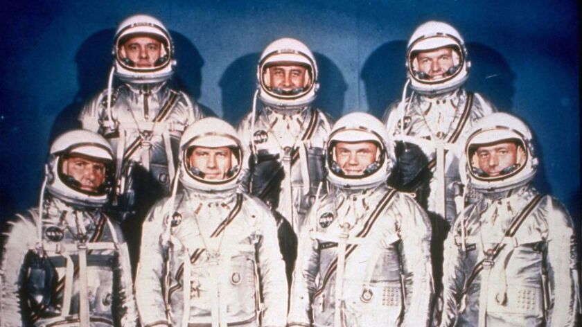 The original seven Mercury astronauts pose in their spacesuits in this 1961 file photo provided by NASA.