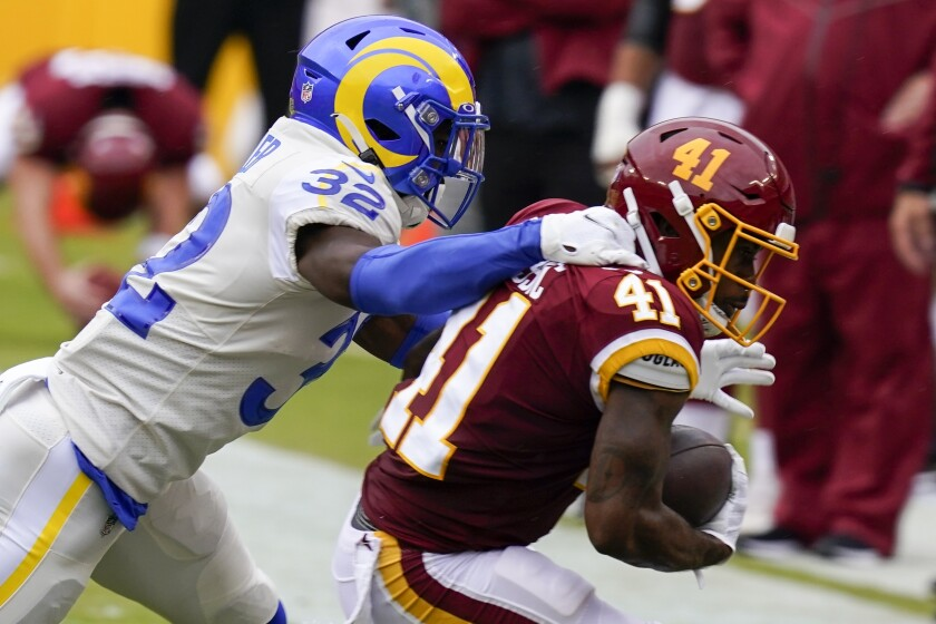 Washington Football Team's J.D. McKissic is stopped by Los Angeles Rams' Jordan Fuller during the first half of an NFL football game Sunday, Oct. 11, 2020, in Landover, Md. (AP Photo/Steve Helber)