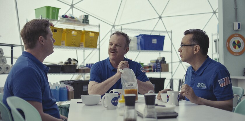 "This image released by Showtime shows, from left, Tim Heidecker, John C. Reilly and Fred Armisen in a scene from ""Moonbase 8,"" a comedy series about astronauts trying to qualify for a moon mission, premiering on Sunday. (Showtime via AP)"