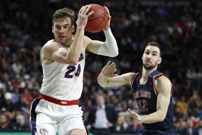 Gonzaga's Corey Kispert (24) drives around Saint Mary's Tommy Kuhse (12) in the first half of the West Coast Conference men's tournament final on Tuesday in Las Vegas.