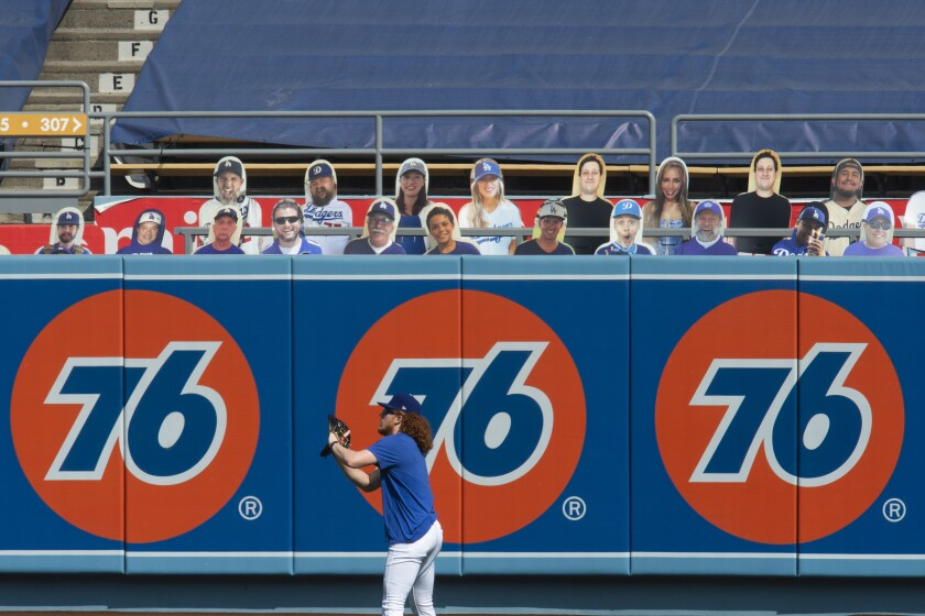 Dodgers pitcher Dustin May warms up before a game against the Angels on Sunday at Dodger Stadium.