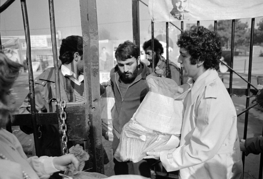 Radio reporter Alex Paen delivers a sack of Christmas cards sent to the U.S. hostages from well-wishers in the U.S. to Tehran, Iran on Dec. 17, 1979. Guards accepted the mail and said it would be distributed after inspection.