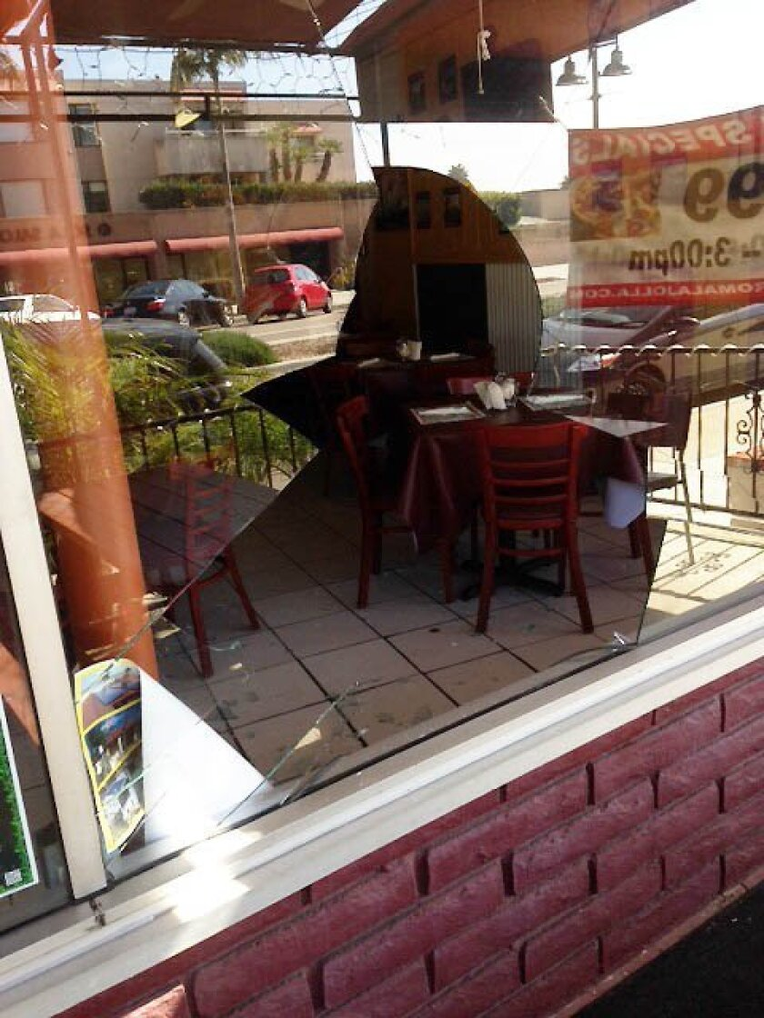 The owner of Bella Roma provided this image of the vandalized window.