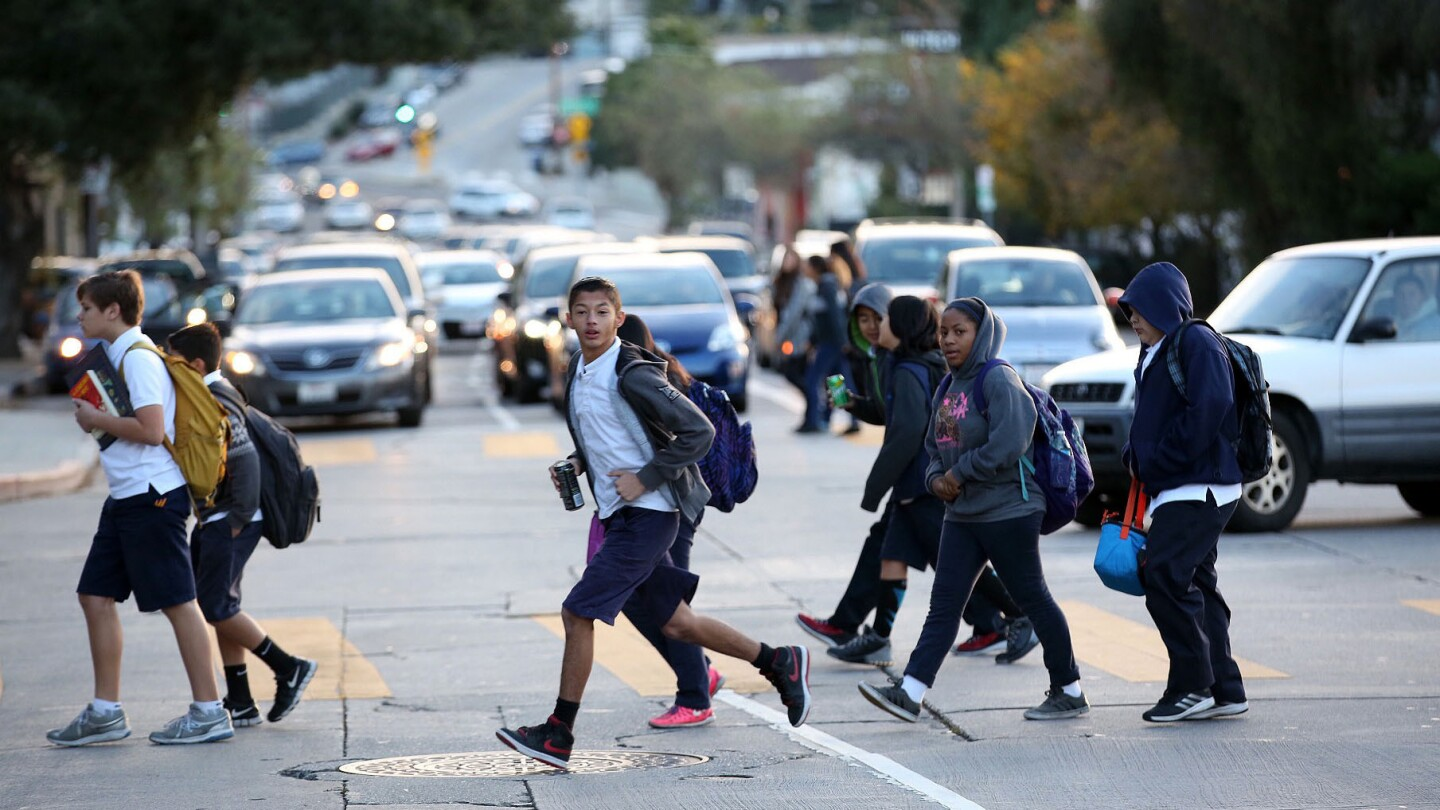 Students cross Fountain Avenue as they return to Thomas Starr King Middle School in East Hollywood on Wednesday morning.