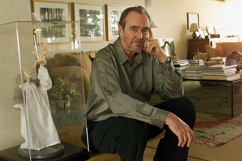 """Horror filmmaker Wes Craven, famous for the """"Nightmare on Elm Street"""" and """"Scream"""" pictures, in a photo for one of his nonhorror forays, 1999's """"Music of the Heart."""""""