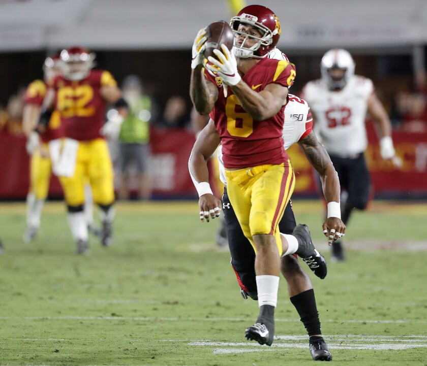 USC wide receiver Michael Pittman makes a big catch against Utah in the fourth quarter at the Coliseum on Friday.