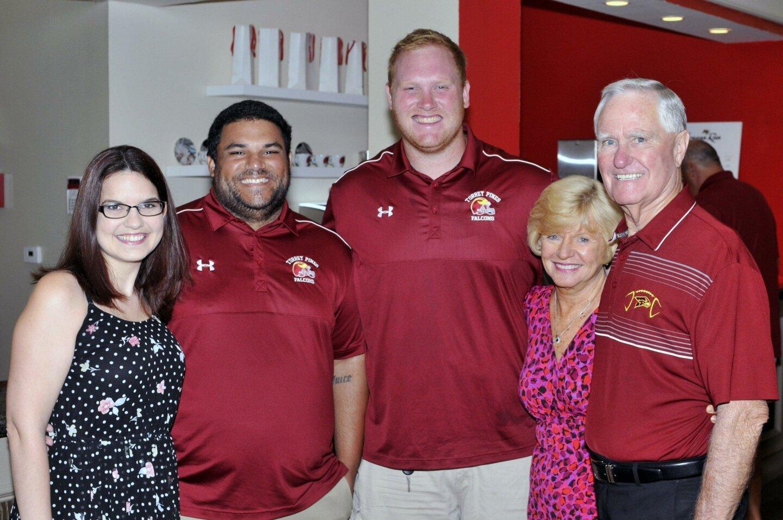 Chevielle and coach Scott Hughley, coach Brian Thomas, Loretta and retired coach Ed Burke