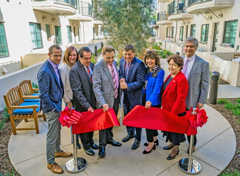 Members of the Glendale City Council and other officials celebrated the grand opening of Vista Grande Court, a new senior affordable-housing complex, on Wednesday with a ribbon cutting ceremony.
