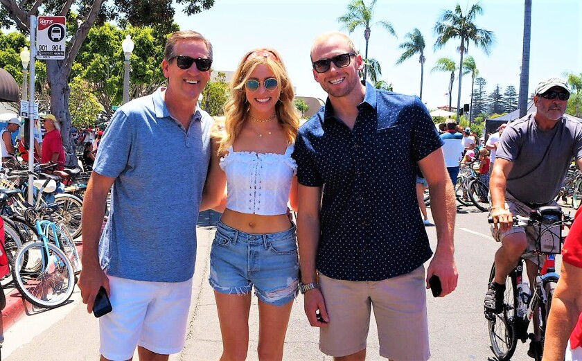Abby Hornacek with dad, Jeff, and brother at previous Coronado July 4th parade.jpeg