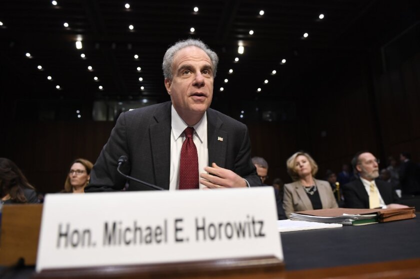 Department of Justice Inspector General Michael Horowitz returns from a break to continue testifying at a Senate Judiciary Committee hearing on Capitol Hill in Washington, Wednesday, Dec. 11, 2019, on the Inspector General's report on alleged abuses of the Foreign Intelligence Surveillance Act.