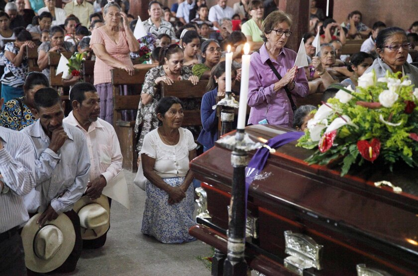 Mourners pray at the funeral for Lesbia Janeth Urquia, an environmentalist and indigenous rights activist, in Marcala, Honduras, on July 8, 2016.
