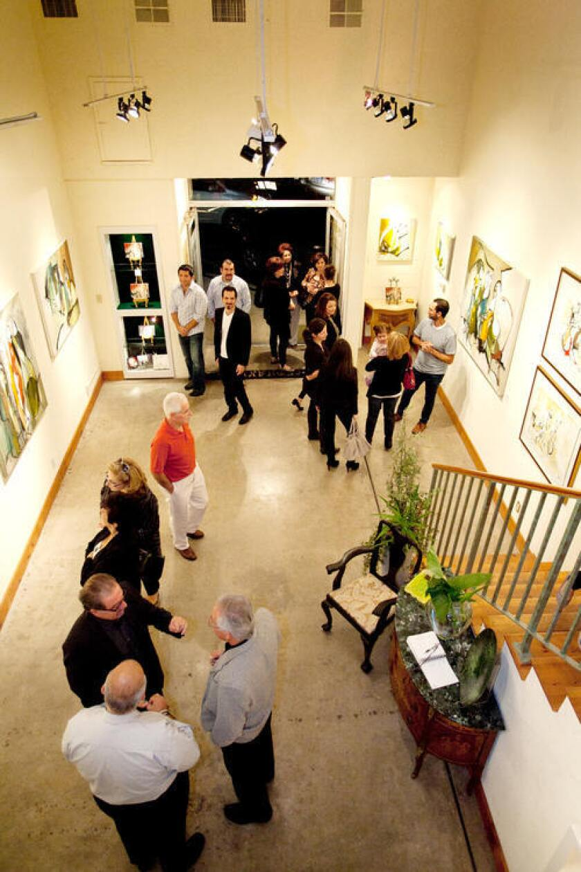 Koko Hovaguimian amidst guests at Stephanie's Art Gallery.