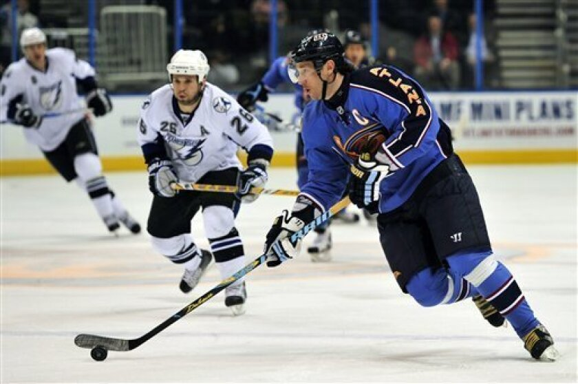 In this Tuesday, Feb. 2, 2010, photo, Atlanta Thrashers left wing Ilya Kovalchuk, right, of Russia, skates against Tampa Bay Lightning right wing Martin St. Louis (26) during an NHL hockey game in Atlanta. Kovalchuk could be traded before the March 3 deadline, although the prolific scorer is not ruling out signing a new contract with Atlanta. Kovalchuk acknowledged meeting with general manager Don Waddell this week and was told the team can't meet his demands for a maximum NHL contract. (AP Photo/Gregory Smith)