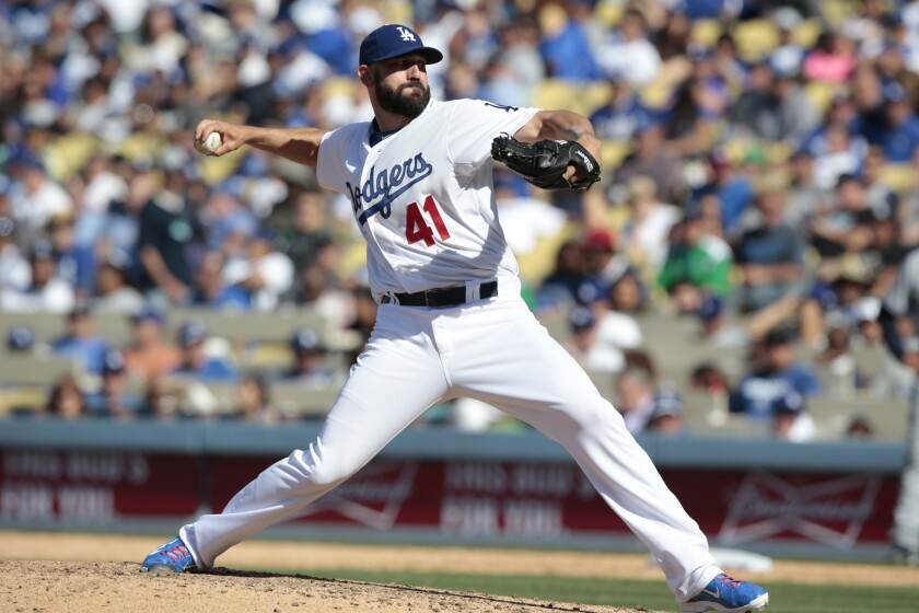 Chris Hatcher is pictured on opening day, when he picked up the save in a 6-3 victory over San Diego. But he has had his struggles, going 1-4 with a 6.38 earned-run average.