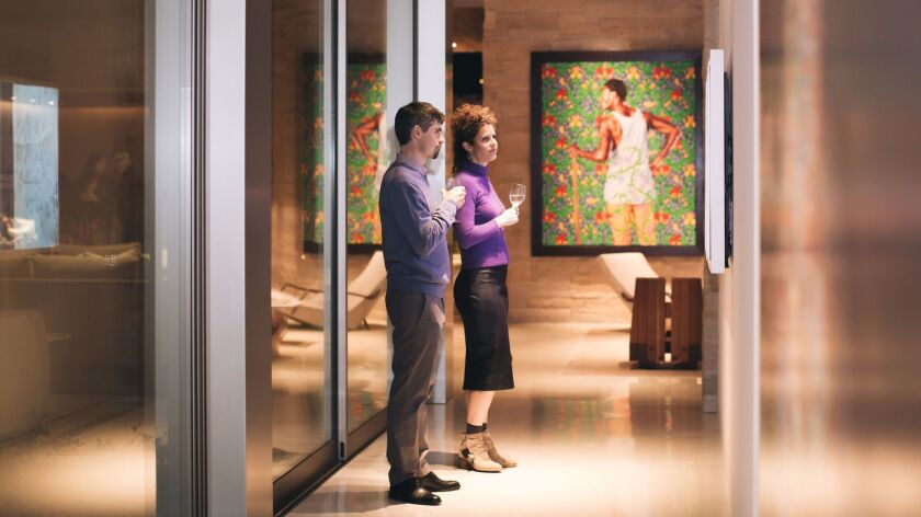 Art patrons admire a private collection at the first 'Cocktails & Collections' event from the Museum of Contemporary Art San Diego.