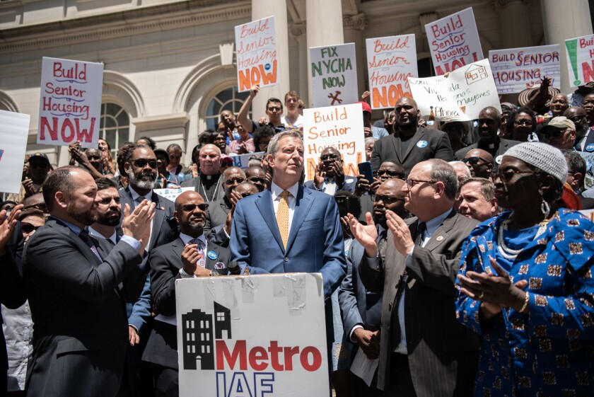 Mayor de Blasio speaks at a Metro IAF rally calling for more affordable housing for senior citizens on the steps of City Hall on June 12.