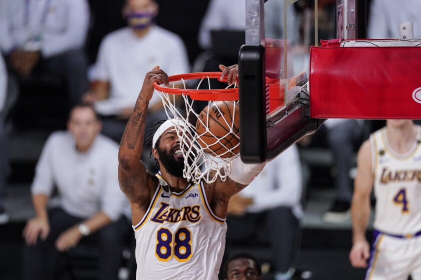Lakers forward Markieff Morris dunks.