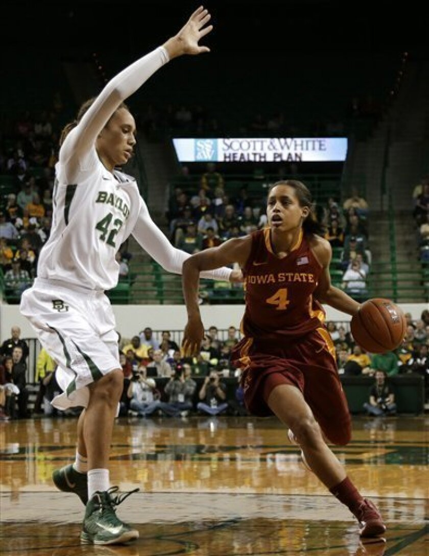 Iowa State's Nikki Moody (4) drives to the basket past Baylor's Brittney Griner (42) in the first half of an NCAA college basketball game on Wednesday, Jan. 9, 2013, in Waco, Texas. (AP Photo/Tony Gutierrez)
