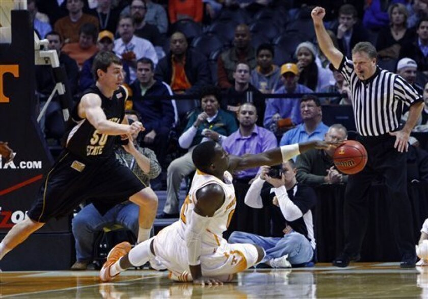 Tennessee center Yemi Makanjuola (0) loses control of the ball as he's fouled by Wichita State forward Jake White (50) in the first half of an NCAA college basketball game on Thursday, Dec. 13, 2012, in Knoxville, Tenn. (AP Photo/Wade Payne)