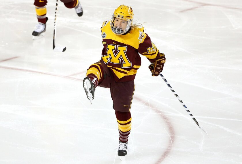 Minnesota's Sarah Potomac celebrates her goal 13 seconds into the game during the first period of the NCAA women's Frozen Four championship college hockey game against Boston College in Durham, N.H. Sunday, March 20, 2016. (AP Photo/Winslow Townson)